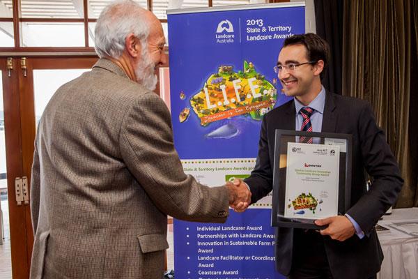 Ian Falconer (left) receiving the award on behalf of the Friends of Aranda Bushland